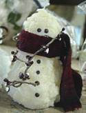 Make your own wax snowman candle.