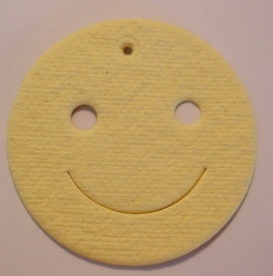 Smiley face with punched out eyes