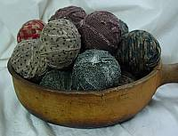 Nice old wooden display filled with rag balls